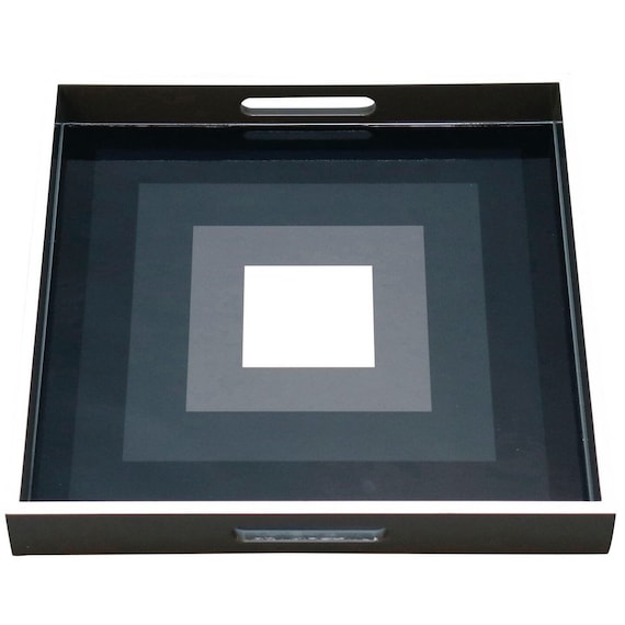 Contemporary lacquered wood tray with geometric Black gray and white squares design.