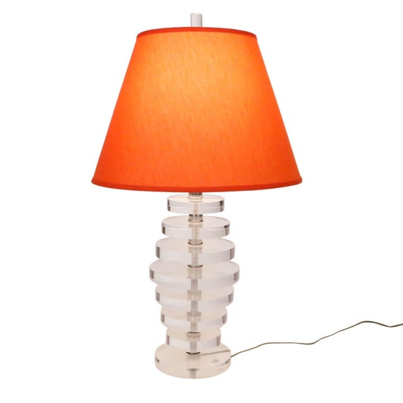 Mid century Lucite table lamp with orange shade