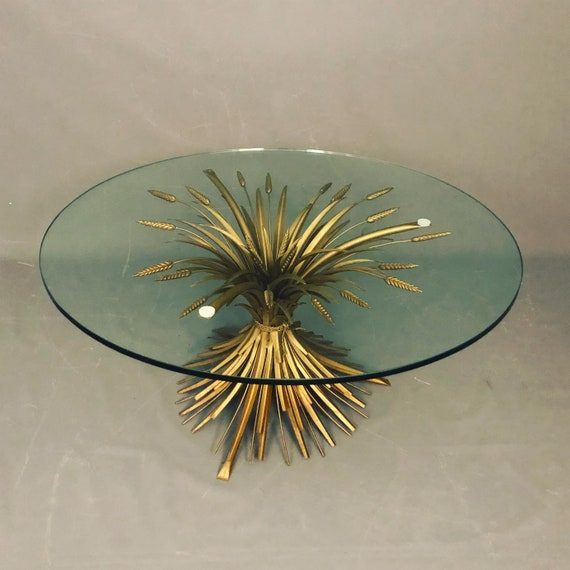 Mid-Century wheat shape brass coffee table with thick heavy round glass.
