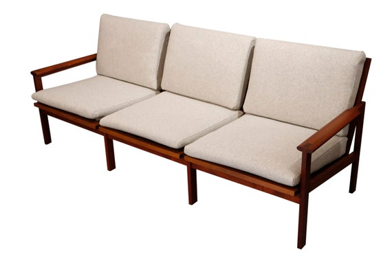 Mid-Century danish teak sofa with 3 seats cushions curated in new wool gray upholstery.