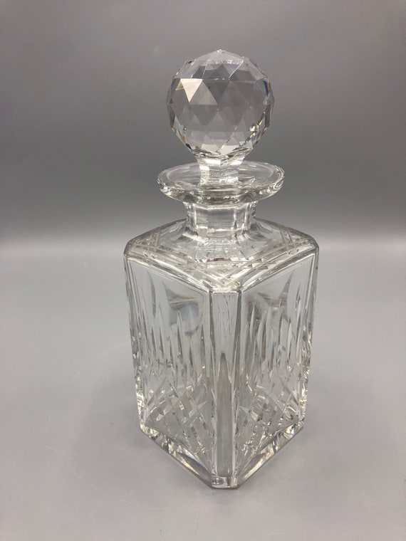 Mid-century crystal decanter with a round  top.