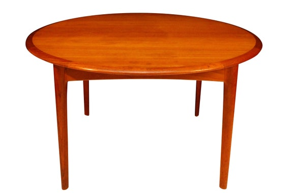 Mid-Century Danish Teak Dinning ya me with hidden leave. Designed by Elsteds Mobler Fabrik Agerbak made in Denmark (Signed) 1960's Circa