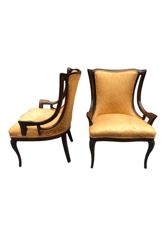 French Heavy Fireside Lounge Arm Side Chairs. Tan upholstery. Carved details. In original condition