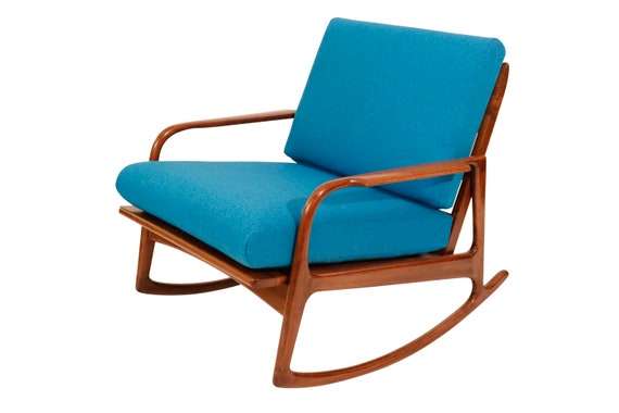 Mid century Danish teak wood curated  Rocking arm lounge chair with new blue kvadrat fabric cushions. 1970's Circa