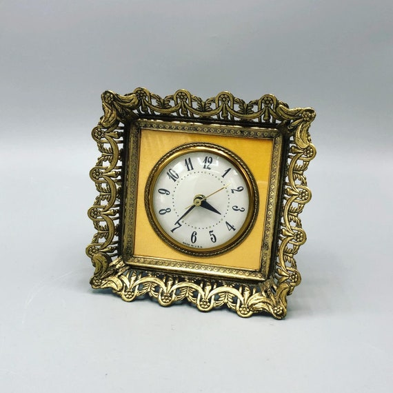 Mid century electric clock with brass frame tested and working  1960's