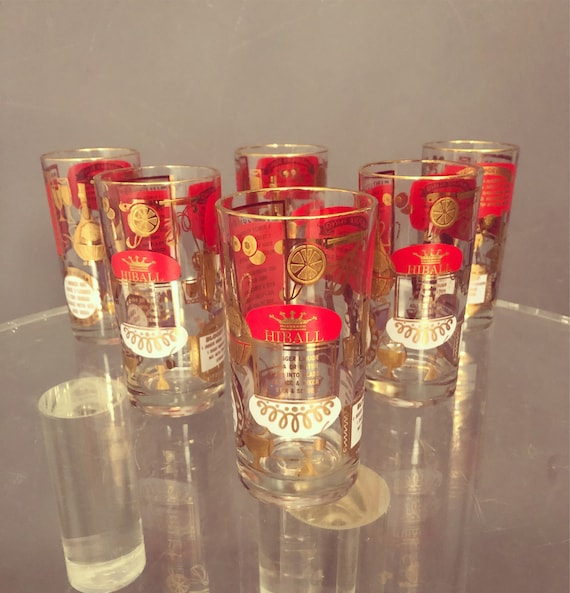 Set of six highball drinking glasses mid century in red and gold detail.