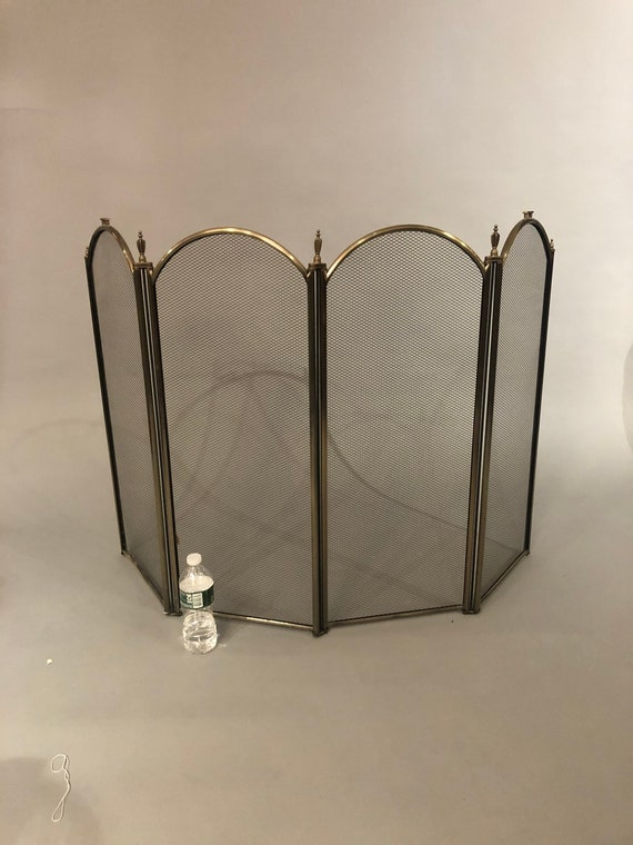 Mid-century metal brass shield for fire place.
