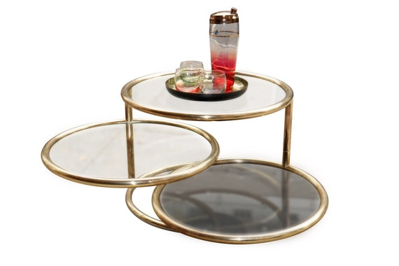 Mid-Century glass & Brass swivel coffee table