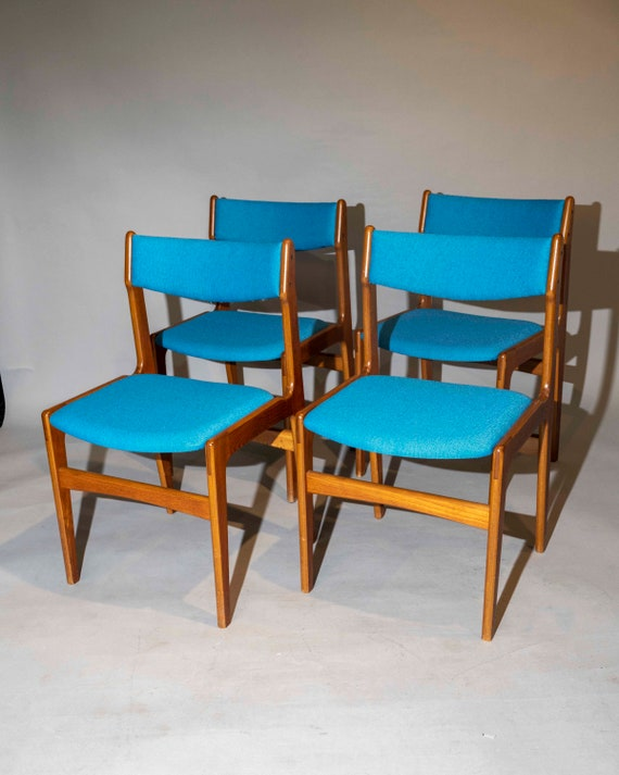 Mid-Century curated set of 4 teak dining chairs with new maharam blue fabric. 1960's Danish.
