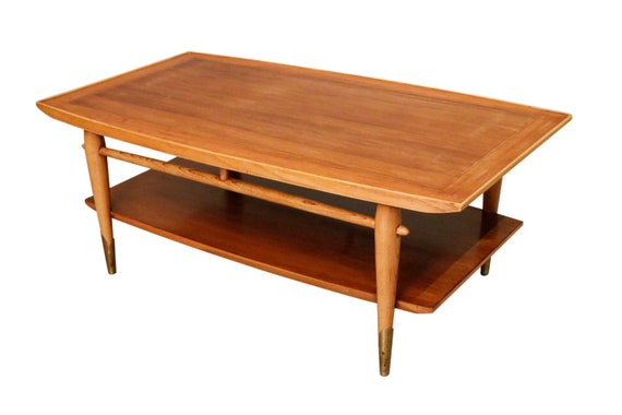 Mid-century curated walnut coffee table with shelf on the bottom 1970 circa