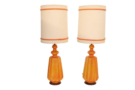 Beautiful pair of  Mid-Century orange ceramic table lamps with original paper and fabric shades.