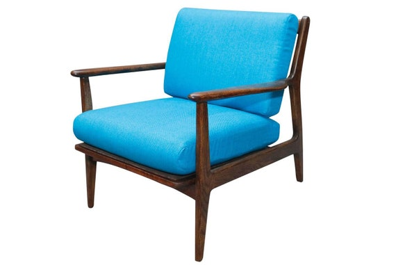 Curated mid century danish walnut arm lounge chair with blue cushions