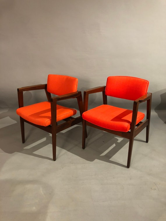 Curated pair of Mid century dining/office chairs with new orange upholstery designed by Gunlock 1960s circa