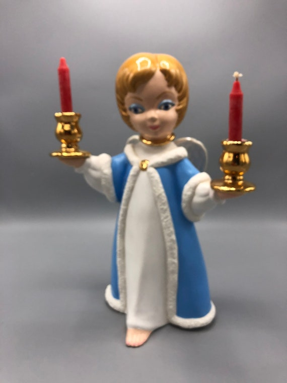Mid century porcelain doll holding candles