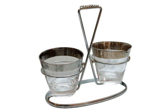 Mid century chrome caddy with 2 serving glass.