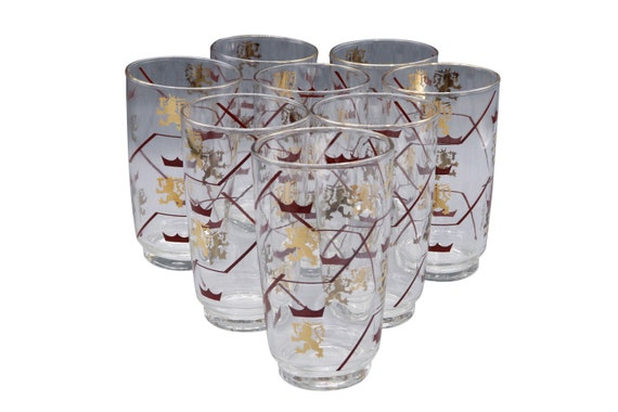 Mid century set up a Tumblr glasses with painted in gold and red with a  gold lion sign 1960's Circa. Set of 7