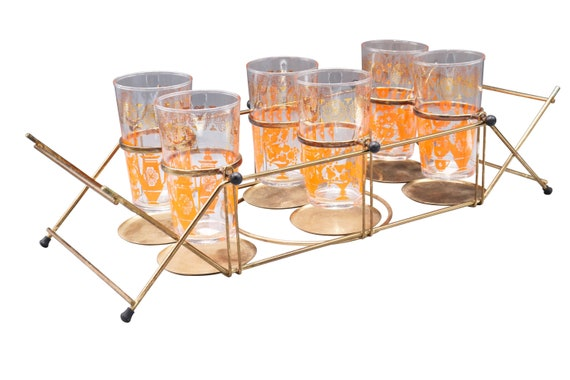 Mid-Century set of 6 highball glasses with orange and gold detail and brass caddy holder.