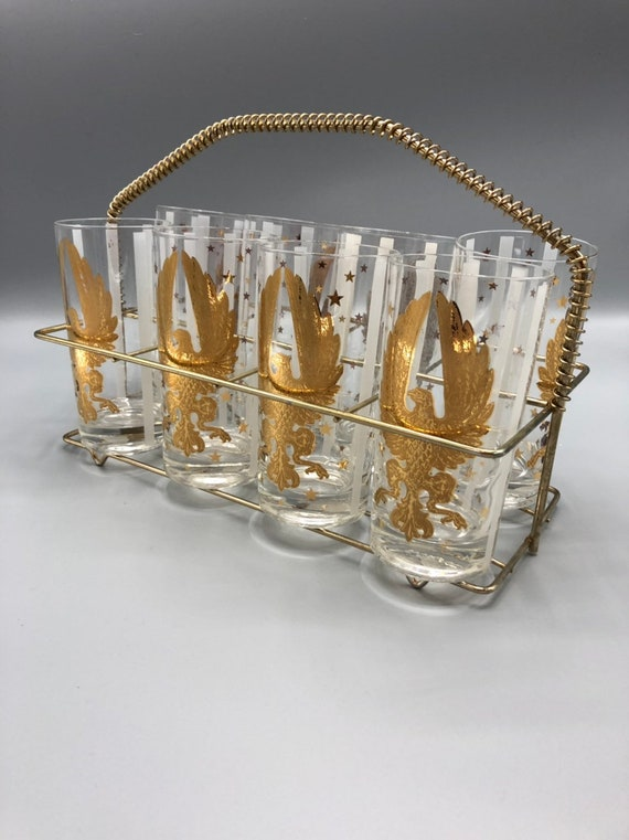 Mid century set of 8 gold & white drinking glasses with a brass caddy