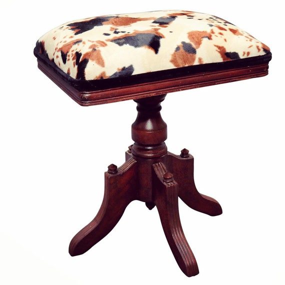 Curated traditional swivel piano stool woth new faux cowhyde.