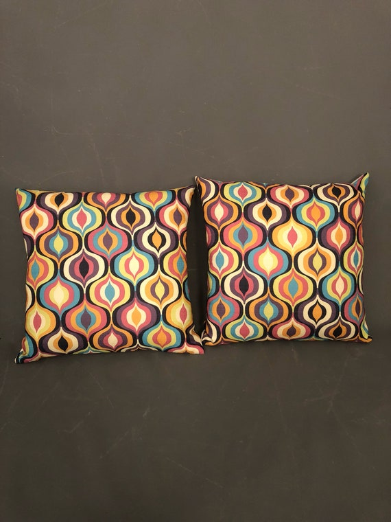 Pair of hand made modern geometric print pillows with white Naugahyde vinyl in the back.