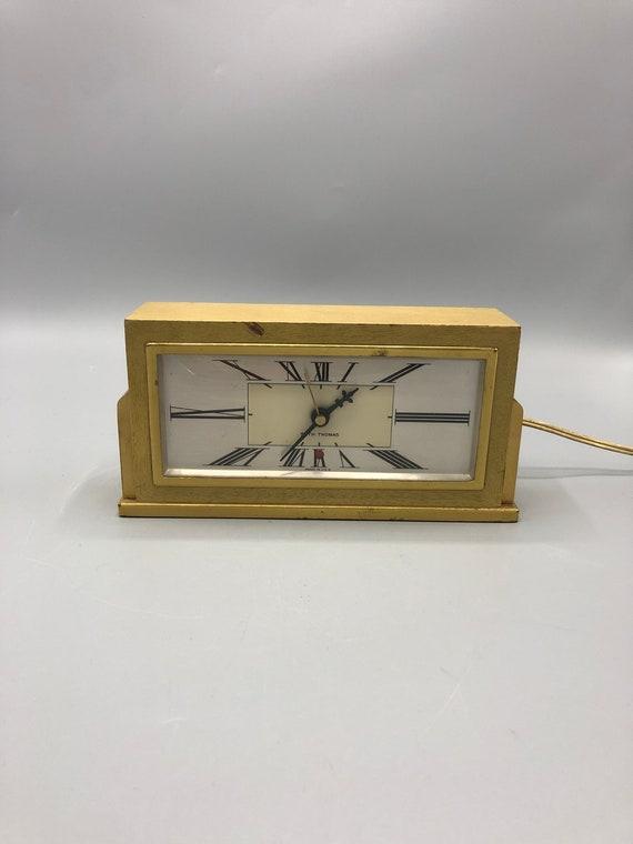 Mid century electric wood clock by Seth Thomas.