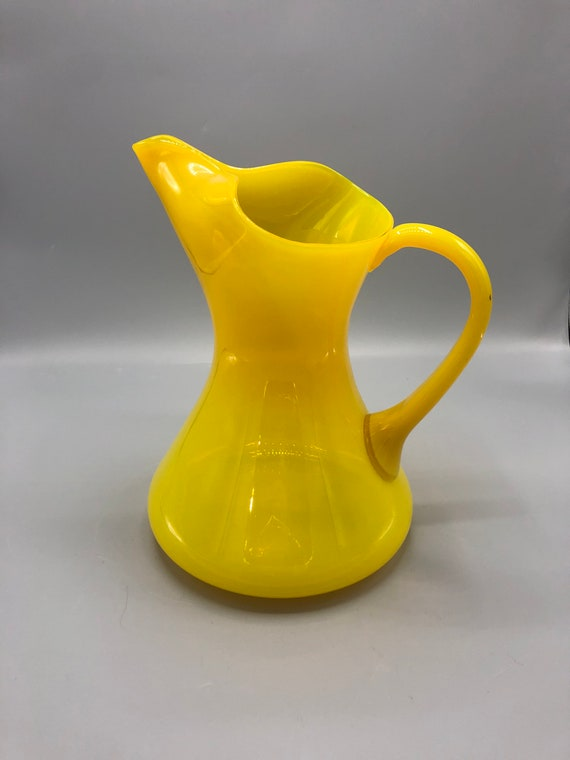 Mid century hand blown yellow picture vase with a handle
