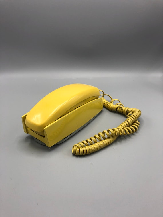 Mid century vintage yellow dial phone