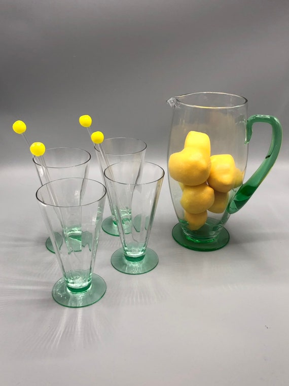 Mid century glass pitcher with 4 highball glasses and straws.