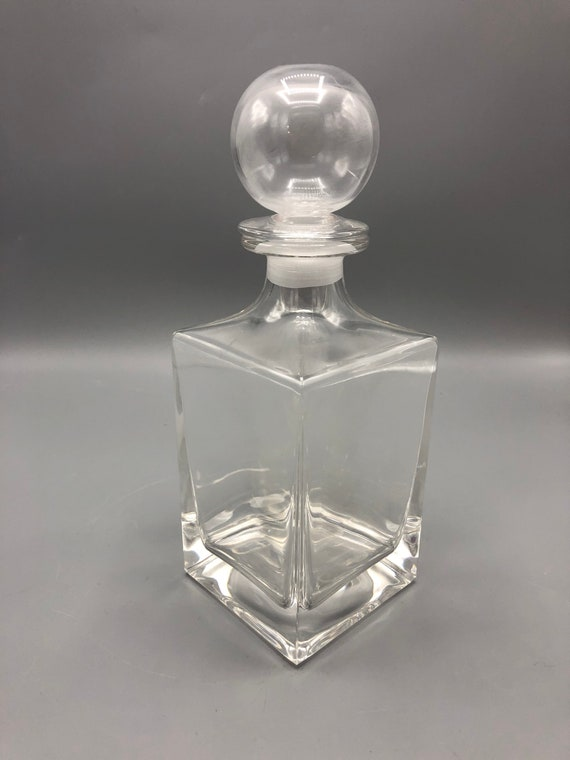 Mid-century crystal decanter with a round top