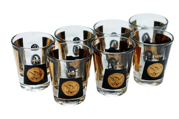 Mid century gold and black coins shot glass set of 7.