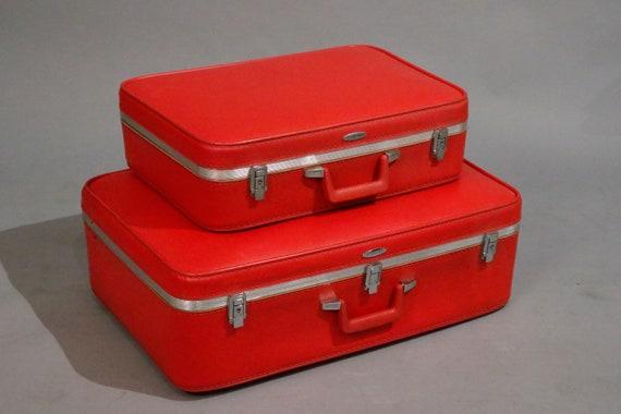 Mid century pair red suitcases