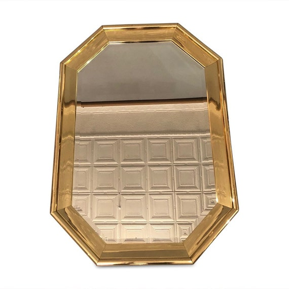 Mid-century Hollywood Regency style wall mirror with thick polish brass frame beveled mirror design by Ethan Allen
