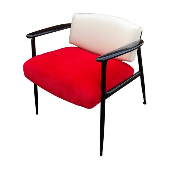 Curated mid-Century low back chair with metal frame and wood paddle arms with new red fur and white naugahyde in the back. Designed Thonet.