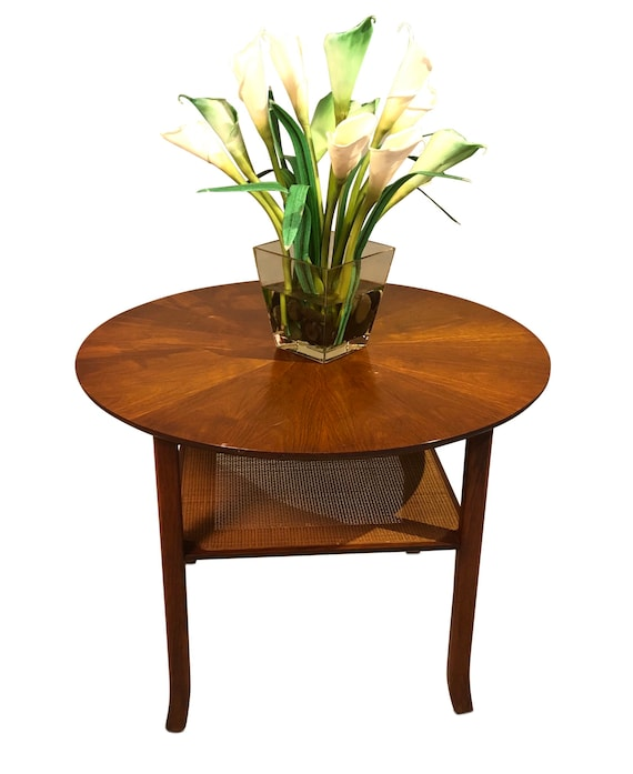 Mid century walnut round circle end tables with canning on the bottom 1960s circa