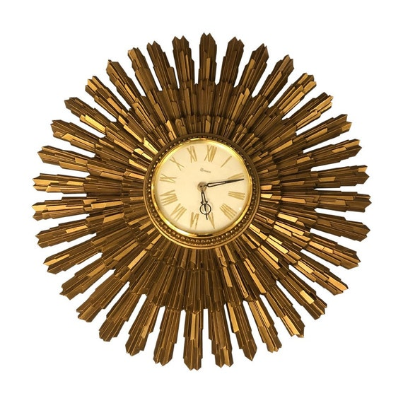 Mid-century starburst gold wall clock on a battery