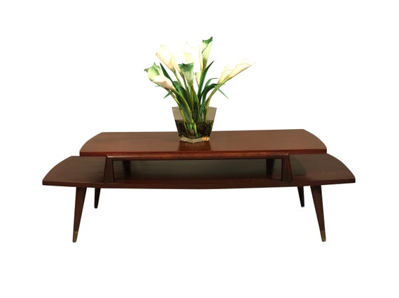 Mid century mahogany two tiers coffee table with brass tips 1960s circa heavy and sturdy