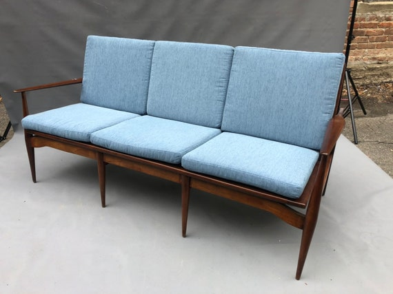 Mid-Century Danish teak sofa with 3 seats.