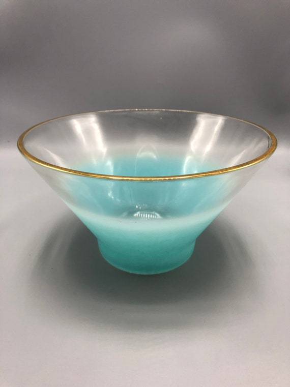 mid century vintage blue glass bowl with gold trim that use for dip and chip