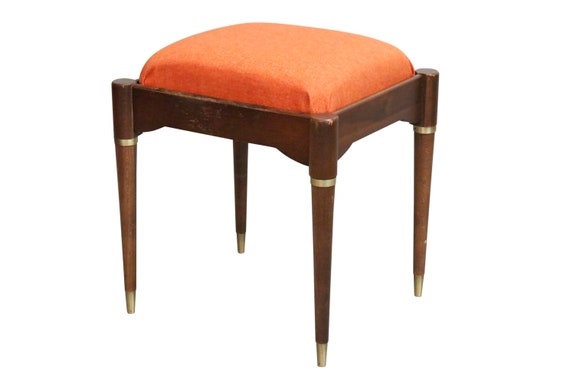 Mid century foot stool or a piano small chair with seat cushion on the top with space under.