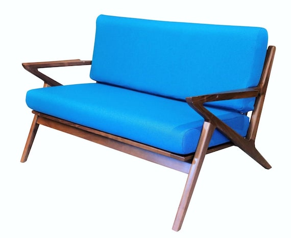 Curated Mid-Century Z Danish arm love seat with new Blue Cushions. 1960's Circa