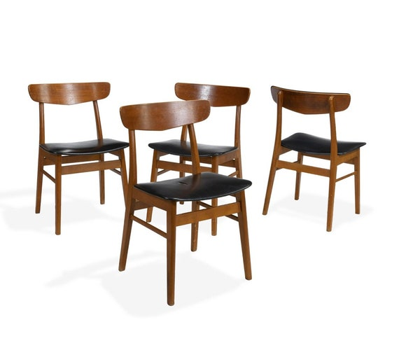 "A set of four Danish style teak  chairs.  Dimensions - 30"" x 17"" x 15"""