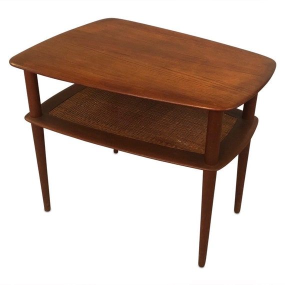 Mid-century two-tier teak end table with canning on the bottom design by Peter Hdvit & Olga