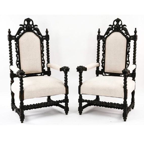Baroque carved wood armchairs Ebonized wood With extensive carving.