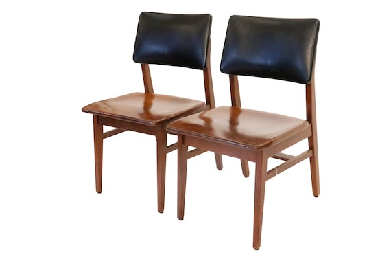 Mid century walnut danish dining chairs with black leather on the back 1970's Circa