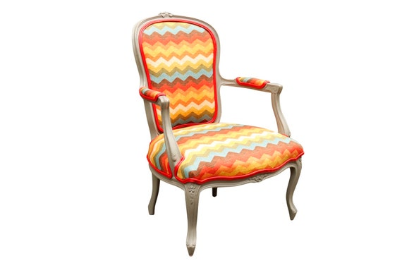 Curated Traditional French lounge chair with new multicolored upholstry