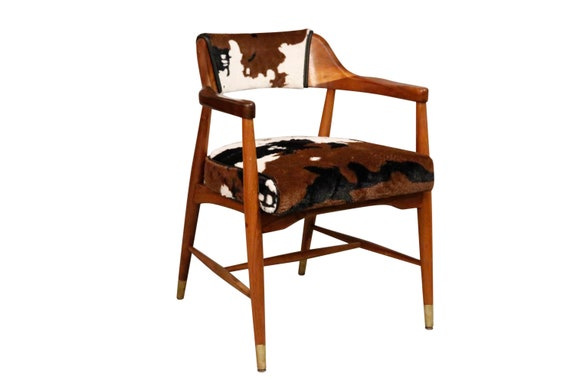 A set of 3 midcentury modern armchairs made by Jasper Seating Company Inc of Jasper, Indiana.