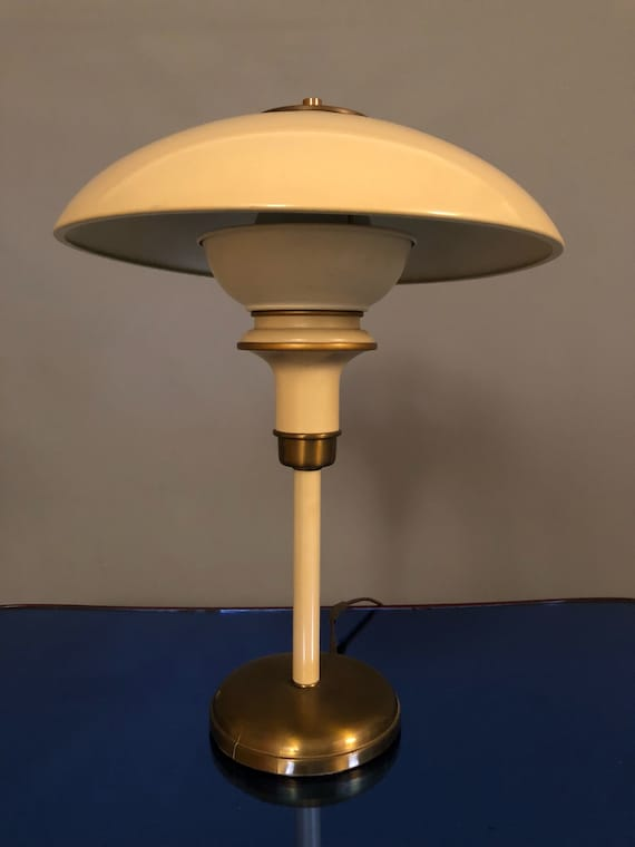 """Gerald Thurston articulating saucer brass and enamel desk lamp for Lightolier. Gorgeous brass patina and creamy """"French Vanilla"""" enamel."""