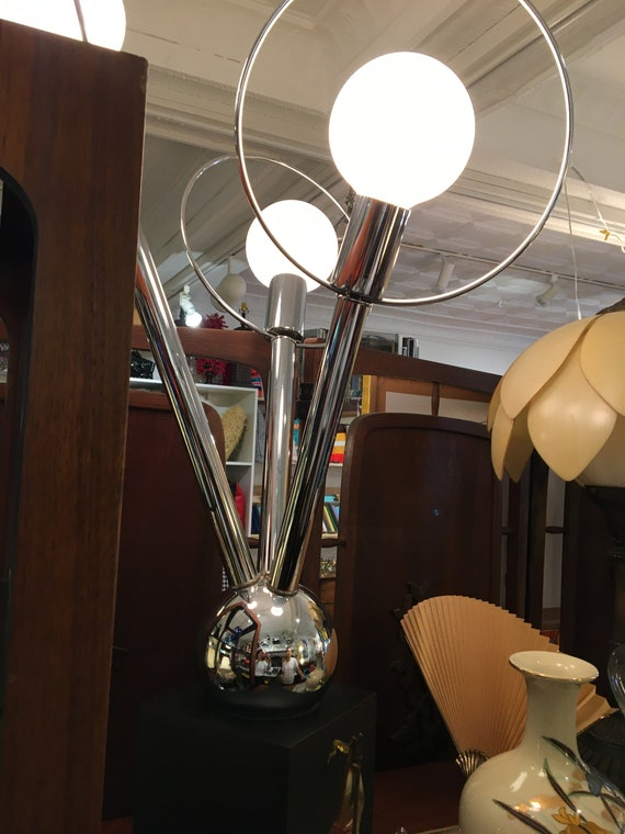 Three globes Mid-Century Modern Chorome Table Lamp with a wood base.