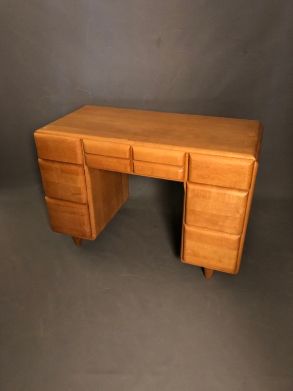 Haywood Wakefield maple executive desk featuring seven drawers