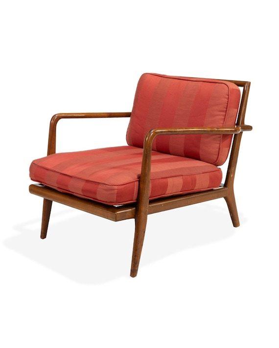 A T.H. Robsjohn-Gibbings style paddle arm lounge chair with vertical spindle  backrest